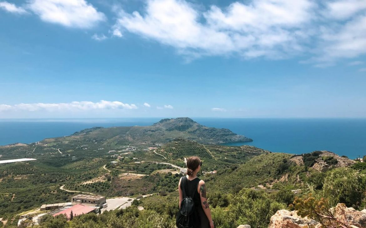 Verena standing on a hill on Crete looking out to sea